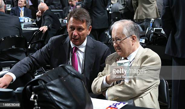 Detroit Red Wings General Manager Ken Holland and Detroit Red Wings Senior Vice President Jim Devellano speak during day two of the 2012 NHL Entry...