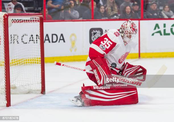 Detroit Red Wings Goalie Jimmy Howard makes a body save in the first period during the NHL game between the Ottawa Senators and the Detroit Red Wings...