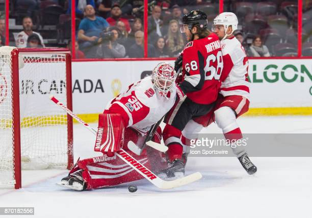 Detroit Red Wings Goalie Jimmy Howard makes a body save in the first period as Ottawa Senators Left Wing Mike Hoffman crashes the net during the NHL...