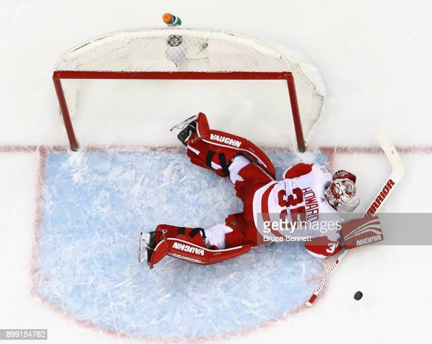Detroit Red Wings goalie Jimmy Howard makes the save against the New Jersey Devils at the Prudential Center on December 27 2017 in Newark New Jersey...