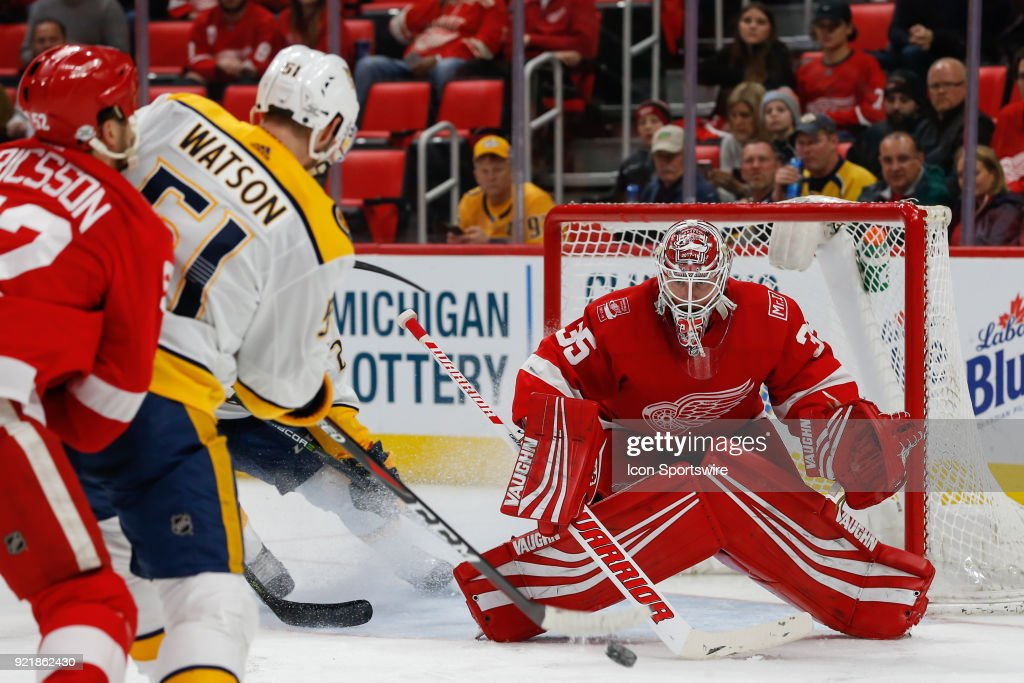 Detroit Red Wings goalie Jimmy Howard (35) protects the net from a shot fired by Nashville Predators forward Austin Watson (51) during the third period of a regular season NHL hockey game between the Nashville Predators and the Detroit Red Wings on February 20, 2018, at Little Caesars Arena in Detroit, Michigan. Nashville defeated Detroit 3-2.