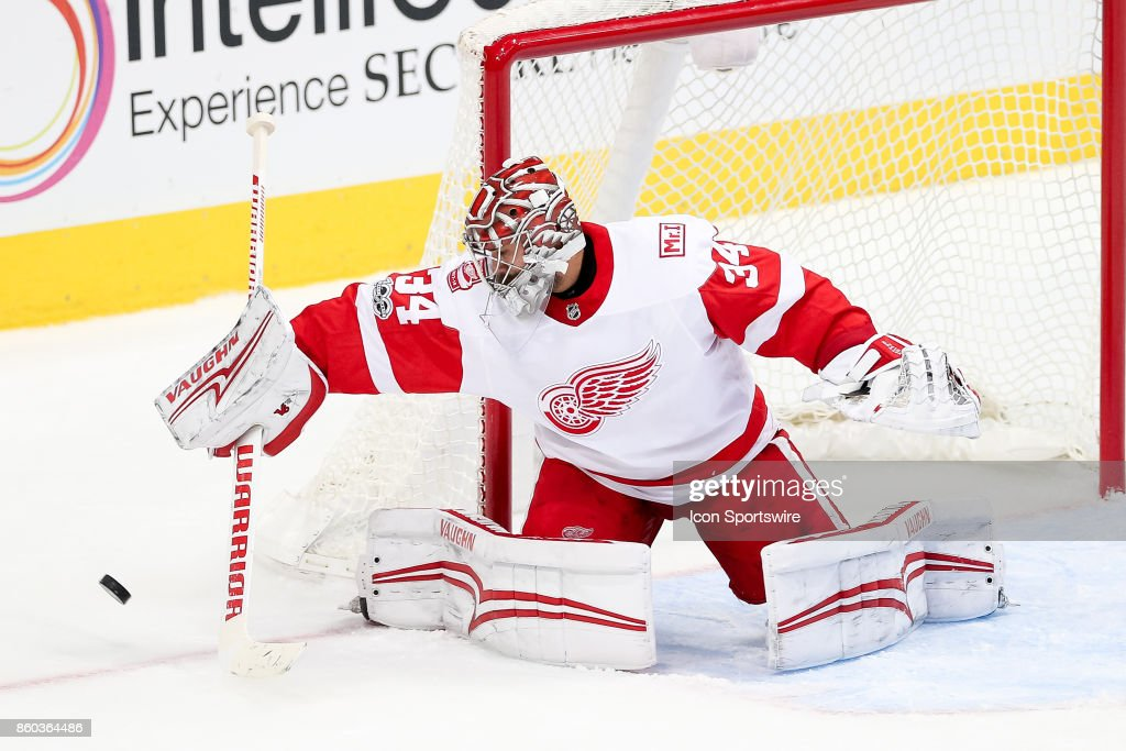 Detroit Red Wings Goalie Petr Mrazek (34) blocks a puck with his stick during the NHL game between the Detroit Red Wings and Dallas Stars on October 10, 2017 at the American Airlines Center in Dallas, TX.