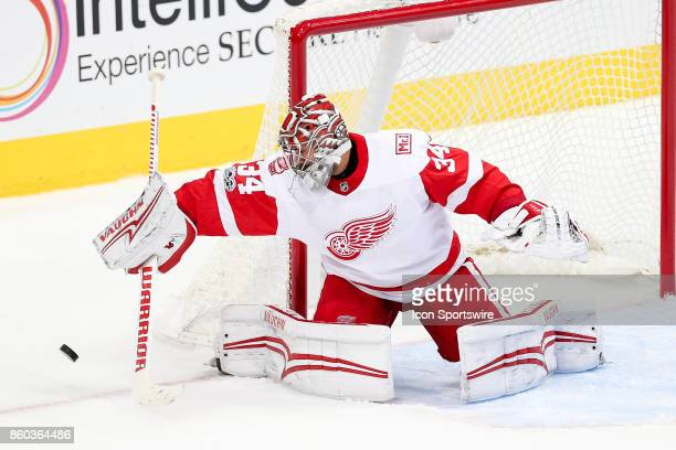 Detroit Red Wings Goalie Petr Mrazek blocks a puck with his stick during the NHL game between the Detroit Red Wings and Dallas Stars on October 10,...
