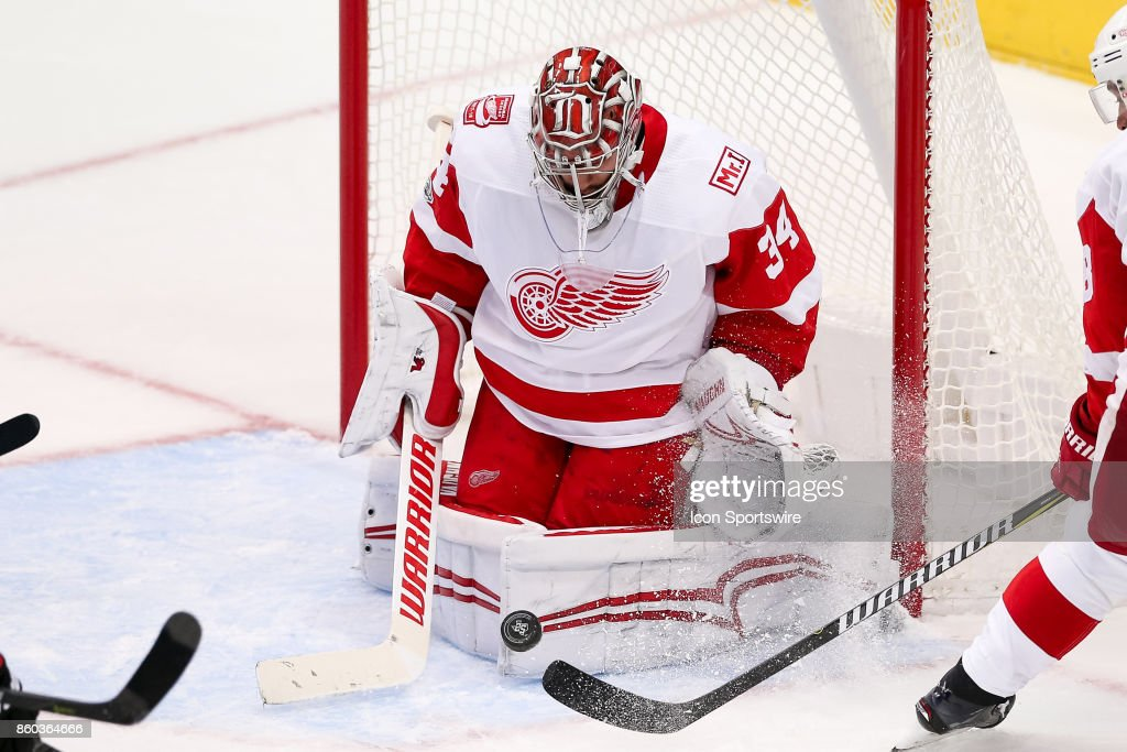 Detroit Red Wings Goalie Petr Mrazek (34) blocks a shot during the NHL game between the Detroit Red Wings and Dallas Stars on October 10, 2017 at the American Airlines Center in Dallas, TX.