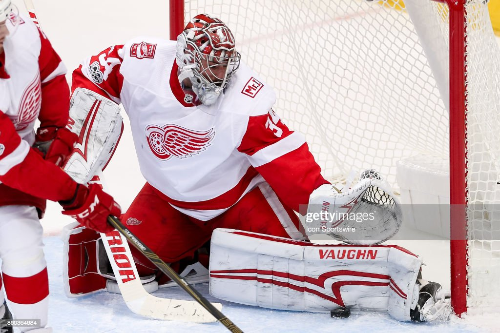 Detroit Red Wings Goalie Petr Mrazek (34) makes a pad save during the NHL game between the Detroit Red Wings and Dallas Stars on October 10, 2017 at the American Airlines Center in Dallas, TX.