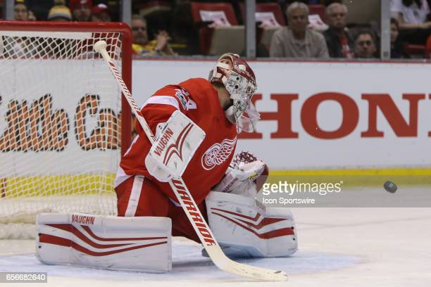 Detroit Red Wings goalie Petr Mrazek of the Czech Republic blocks a shot during the second period of a regular season NHL hockey game between the...