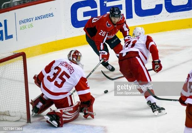 Detroit Red Wings goaltender Jimmy Howard and center Dylan Larkin combine to block a third period shot by Washington Capitals center Lars Eller on...