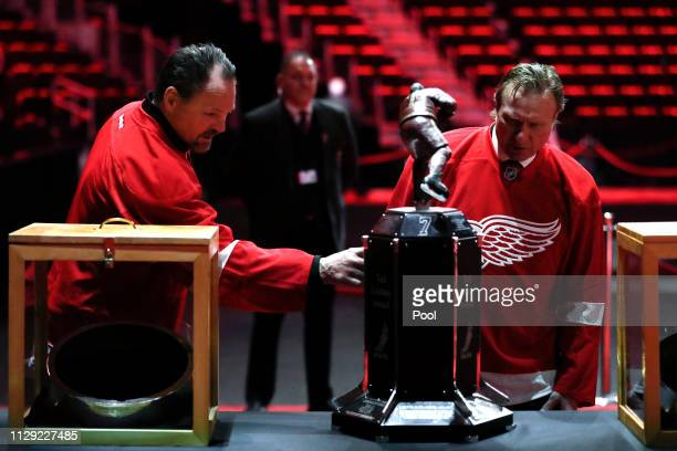 Detroit Red Wings head coach Jeff Blashill and general manager Ken Holland speak with Blake Lindsay son of former player Ted Lindsay at a public...