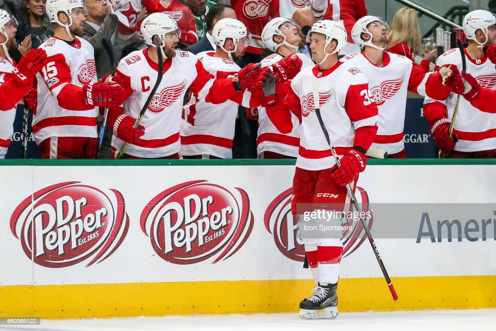 Detroit Red Wings Left Wing Anthony Mantha (39) slaps gloves after scoring a goal during the 3rd period of the NHL game between the Detroit Red Wings and Dallas Stars on October 10, 2017 at the American Airlines Center in Dallas, TX.