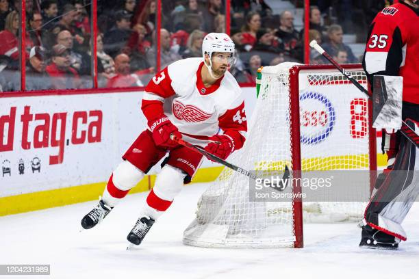 Detroit Red Wings Left Wing Darren Helm skates around the net during first period National Hockey League action between the Detroit Red Wings and...