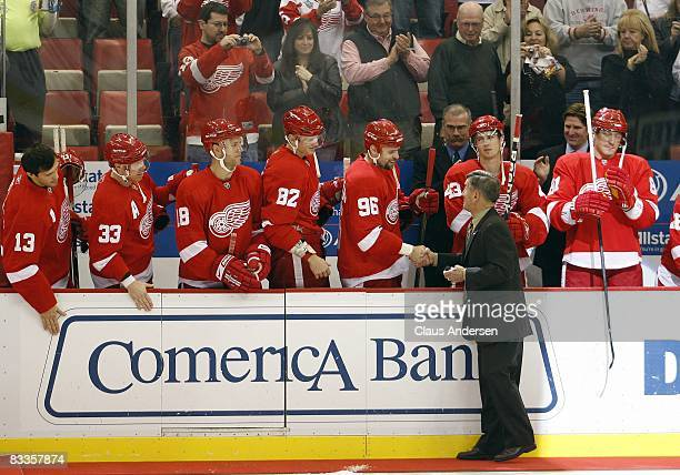 Detroit Red Wings legend Ted Lindsay shakes hands with Detroit Red Wing players prior to the game against the New York Rangers on October 18 2008 at...