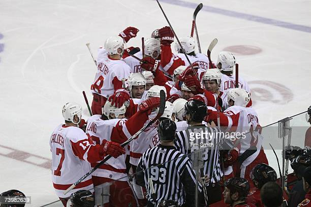 Detroit Red Wings players celebrate their victory over the Calgary Flames in Game 6 of the 2007 Western Conference Quarterfinals at Pengrowth...