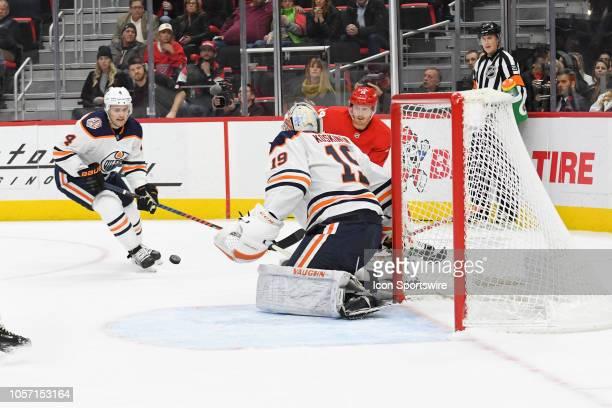Detroit Red Wings Right Wing Gustav Nyquist centers the puck between Edmonton Oilers Goalie Mikko Koskinen and Edmonton Oilers Defenceman Kris...