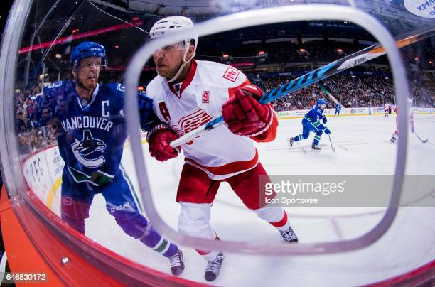 Detroit Red Wings Right Wing Justin Abdelkader checks Vancouver Canucks Center Henrik Sedin into the glass during a NHL hockey game on February 28 at...