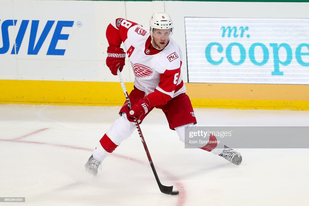 Detroit Red Wings Right Wing Justin Abdelkader (8) stick handles the puck during the NHL game between the Detroit Red Wings and Dallas Stars on October 10, 2017 at the American Airlines Center in Dallas, TX.