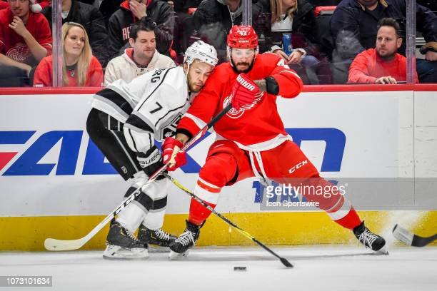 Detroit Red Wings right wing Martin Frk checks Los Angeles Kings defenseman Oscar Fantenberg off of the puck during the Detroit Red Wings game versus...
