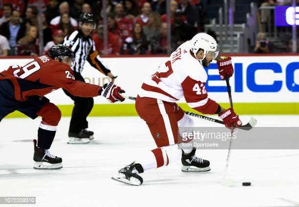 Detroit Red Wings right wing Martin Frk fires shot as Washington Capitals defenseman Christian Djoos defends on December 11 at the Capital One Arena...