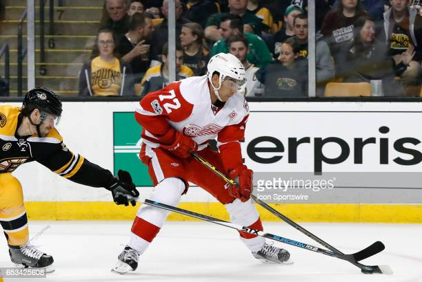 Detroit Red Wings winger Andreas Athanasiou breaks away from Boston Bruins right defenseman Adam McQuaid during a regular season NHL game between the...