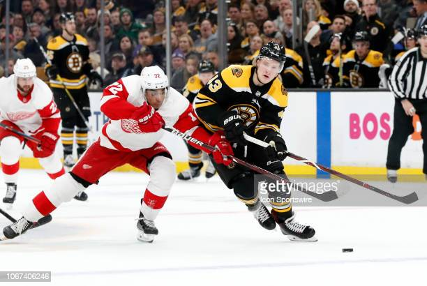 99cae1410f8 Detroit Red Wings winger Andreas Athanasiou muscles in on Boston Bruins  left wing Danton Heinan during