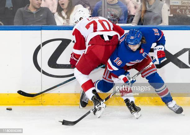 Detroit Red Wings Winger Christoffer Ehn and New York Rangers Left Wing Artemi Panarin battle for the puck during the National Hockey League game...