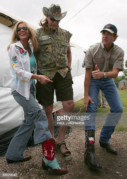 Detroit Rocker Ted Nugent his wife Shemane and Texas Governor Rick Perry show off their boots and feet as Nugent and the Texas Governor prepare to do...