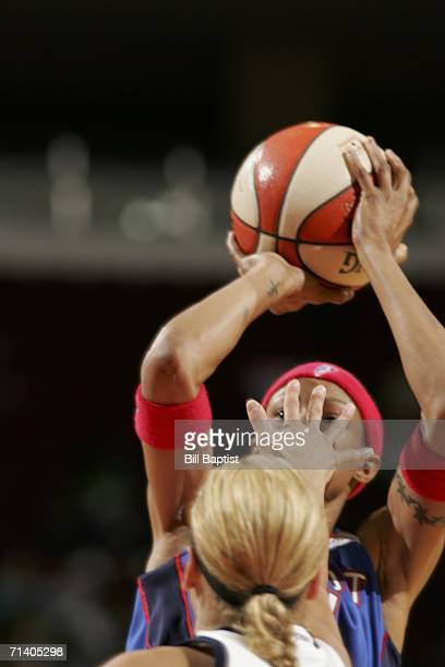 Detroit Shock guard Deanna Nolan shoots while Houston Comets guard Anastasia Kostaki puts a hand in her face during the Comets vs Shock game July 9...