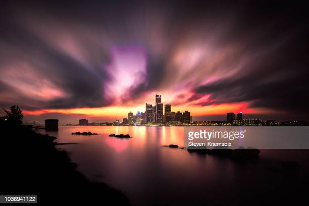 detroit skyline as seen from windsor, ontario, canada - long exposure - detroit river stock pictures, royalty-free photos & images