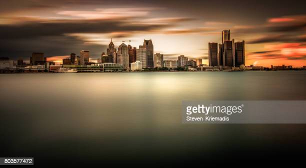 detroit skyline long exposure at dusk - detroit michigan stock pictures, royalty-free photos & images