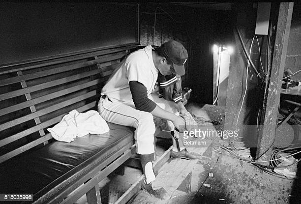 Detroit Tiger pitcher Earl Wilson sits alone in the Tiger dugout long after the rest of the team went to the dressing room following defeat by the...