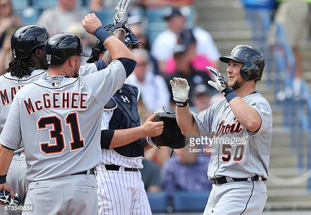 Detroit Tigers Bryan Holaday celebrates with his teammates Cameron Maybin and Casey McGehee after hitting a second inning grand slam during the...
