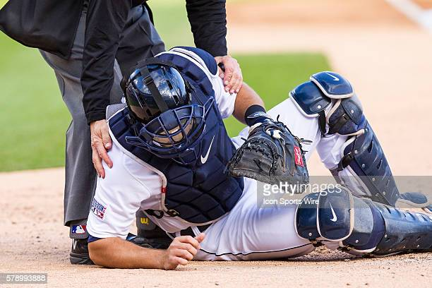 Detroit Tigers catcher Alex Avila staggers to get up after being hit be a foul tip in the face mask during the sixth inning of game three of the...