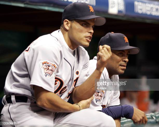 Detroit Tigers catcher Ivan Rodriguez and hitting coach Bruce Fields have a discussion during Thursday night's game against the Tampa Bay Devil Rays...
