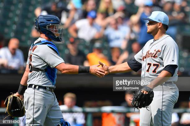 Detroit Tigers catcher James McCann and Detroit Tigers relief pitcher Joe Jimenez shake hands after getting the team win against the Chicago White...