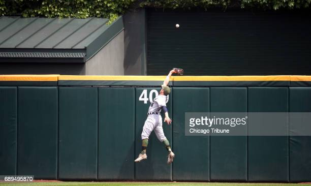 Detroit Tigers center fielder Alex Presley can't make the catch on a home run by Chicago White Sox designated hitter Matt Davidson in the fourth...