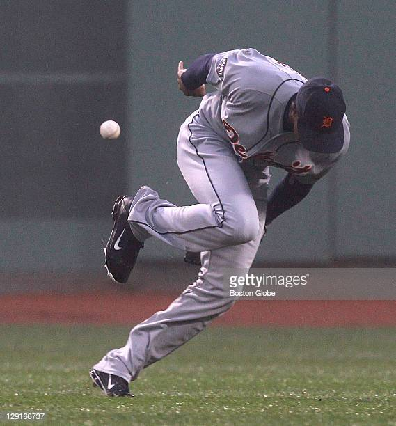 Detroit Tigers center fielder Austin Jackson can't make the catch of a drive to center by Boston Red Sox second baseman Dustin Pedroia that ell for a...