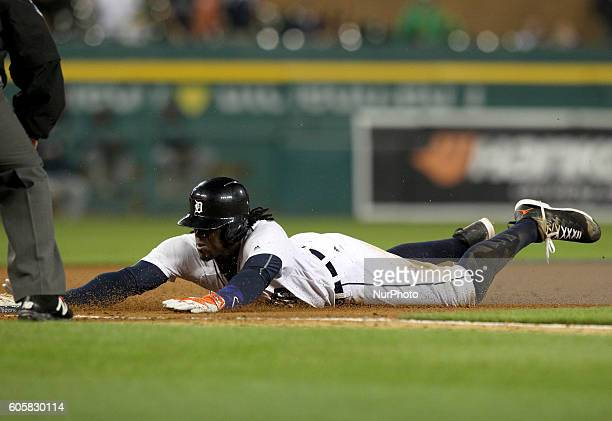 Detroit Tigers center fielder Cameron Maybin slides safe to third base after hitiing a triple in the fourth inning of a baseball game against the...