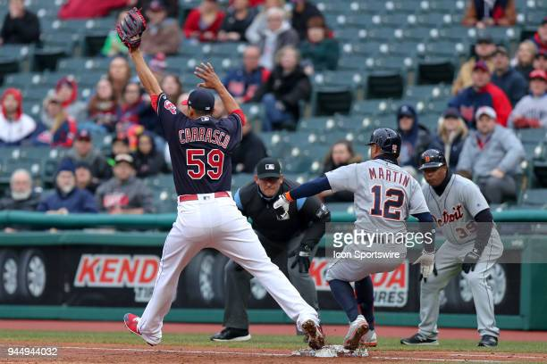 Detroit Tigers center fielder Leonys Martin beats the throw to Cleveland Indians starting pitcher Carlos Carrasco as he reaches on an infield single...