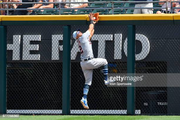 Detroit Tigers center fielder Leonys Martin climbs the fence to catch the fly ball for an out against the Chicago White Sox on June 17 2018 at...