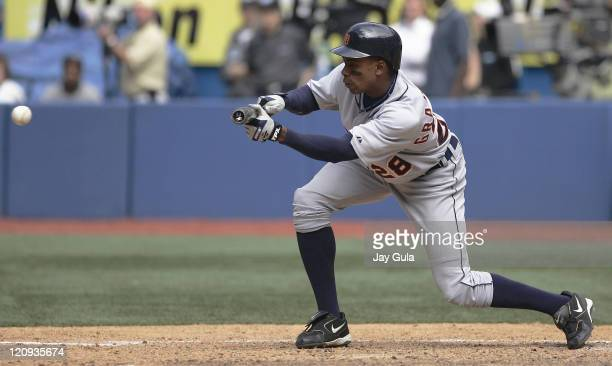 Detroit Tigers Curtis Granderson lays down a sacrifice bunt during the game against the Toronto Blue Jays at Rogers Centre in Toronto Canada on June...