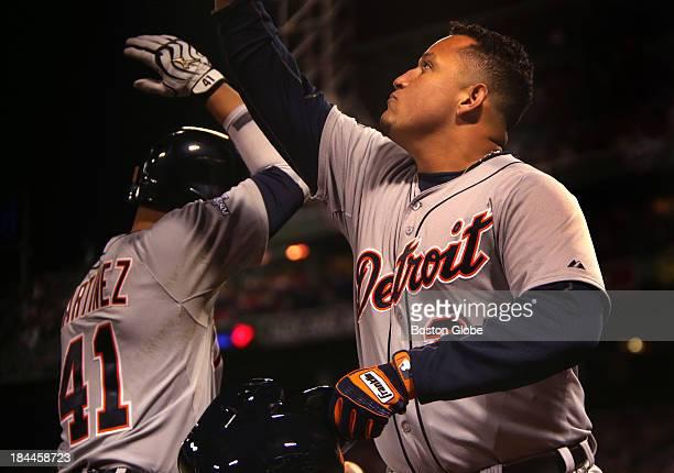 Detroit Tigers designated hitter Victor Martinez and Detroit Tigers third baseman Miguel Cabrera celebrate Cabrera's home run. The Boston Red Sox...