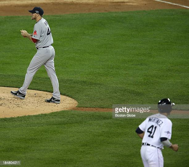 Detroit Tigers designated hitter Victor Martinez heads home after Red Sox pitcher Jake Peavy issued a bases loaded walk in the second inning The...
