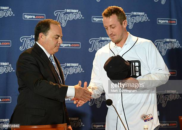 Detroit Tigers Executive Vice President of Baseball Operations and General Manager Al Avila shakes hands with new Tigers pitcher Jordan Zimmermann...