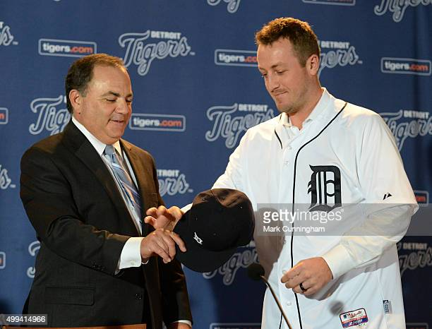 Detroit Tigers Executive Vice President of Baseball Operations and General Manager Al Avila hands a baseball hat to new Tigers pitcher Jordan...