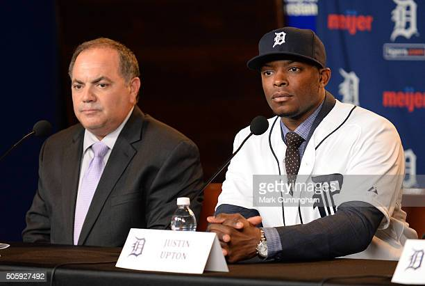 Detroit Tigers Executive Vice President of Baseball Operations and General Manager Al Avila and newest Tiger Justin Upton look on during the press...