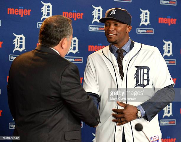 Detroit Tigers Executive Vice President of Baseball Operations and General Manager Al Avila shakes hands with newest Tiger Justin Upton during the...