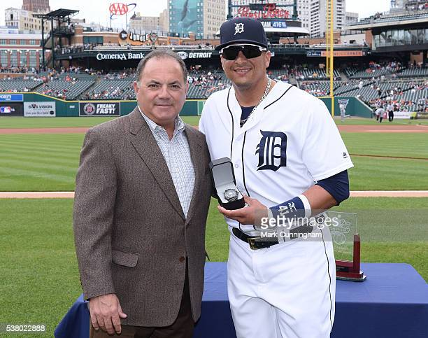 Detroit Tigers Executive Vice President of Baseball Operations and General Manager Al Avila presents Victor Martinez with his American League Player...