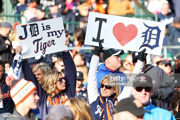 Detroit Tigers fans hold up signs supporting their team during Game Three of the American League Division Series against the Baltimore Orioles at...