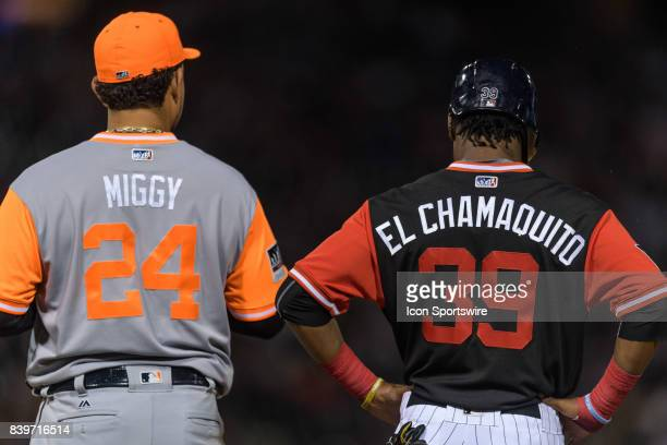Detroit Tigers first baseman Miguel Cabrera and Chicago White Sox outfielder Alen Hanson stand side by side wearing custom jerseys during players...