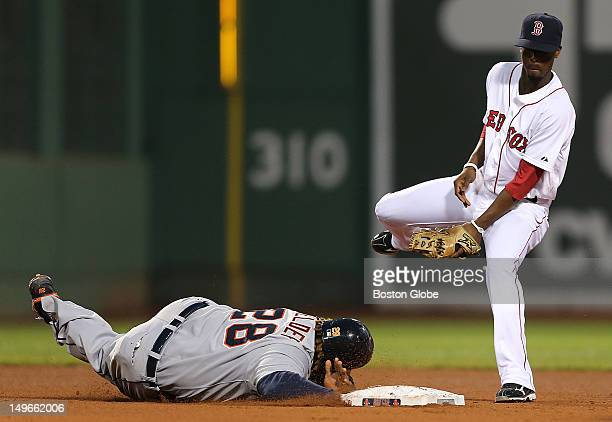 Detroit Tigers first baseman Prince Fielder dives back into second base during the fourth inning as the Boston Red Sox took on the Detroit Tigers at...