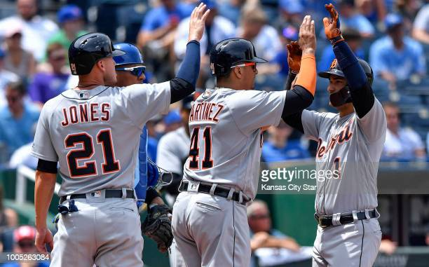 Detroit Tigers' Jose Iglesias is congratulated on his threerun home run by Victor Martinez and JaCoby Jones in the fourth inning in front of Kansas...